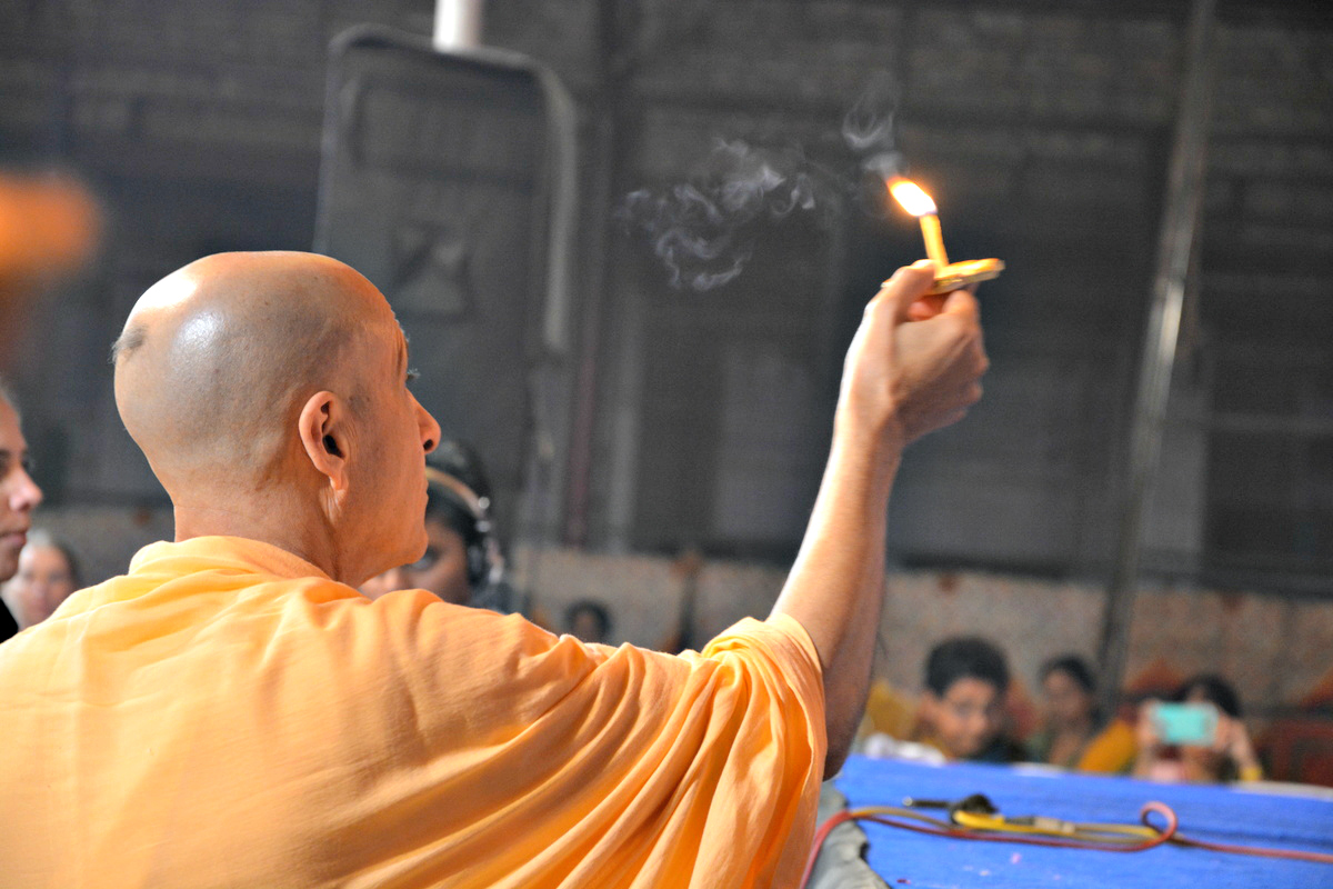 Radhanath Swami offering Lamp to Radha Damodar.